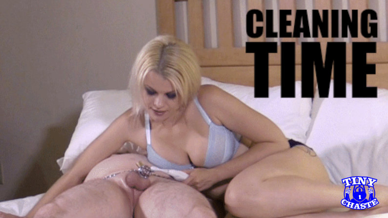 cleaning a chastity submissive's caged cock